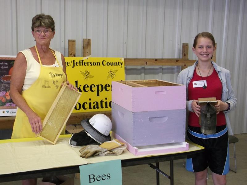 Members giving a presentation on beekeeping.
